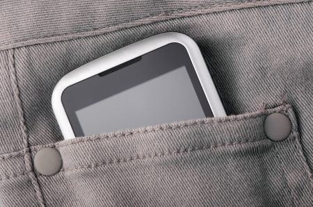 Mobile phone in gray jeans pocket photo