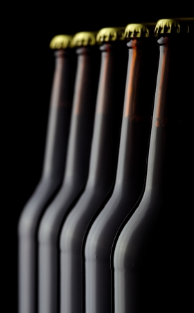 Close up bottles of beer on a black background photo