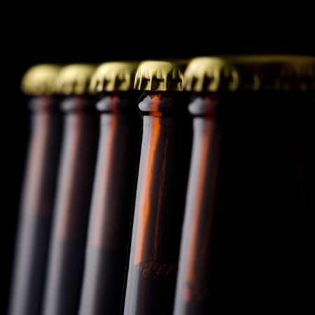 Close up bottles of beer on a black background photo