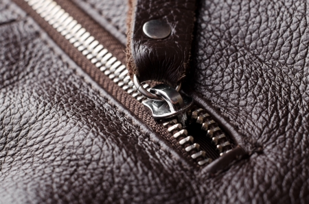 Closeup of opening clothing zipper photo