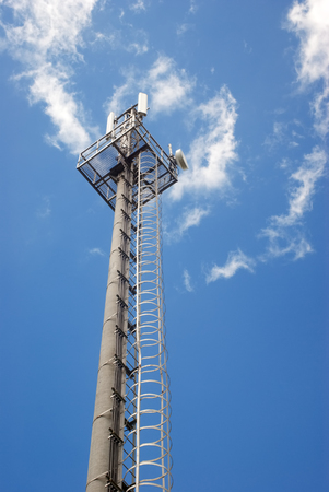 Photography of mobile connection toweron blue sky background photo