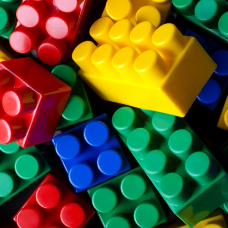 yellow lego block: The background photo of multicolour toy bricks