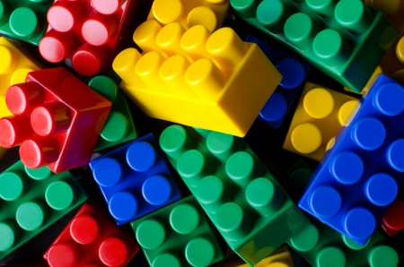 The background photo of multicolour toy bricks