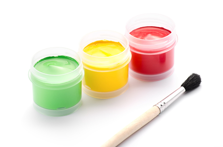 Brush and gouache jars on a white background photo