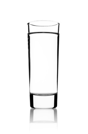 intoxicant: Glass of vodka on a white background Stock Photo