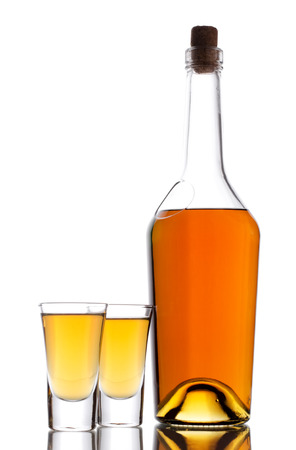 intoxicant: Two shot of whisky and bottle on a white Stock Photo