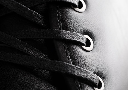 Close-up photo of black shoelaces on boot