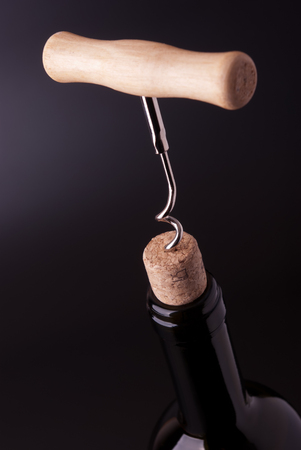closed corks: Wine bottle uncorking with corkscrew Stock Photo