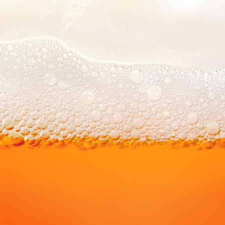 froth: Closeup photo bubbles of beer froth in glass Stock Photo