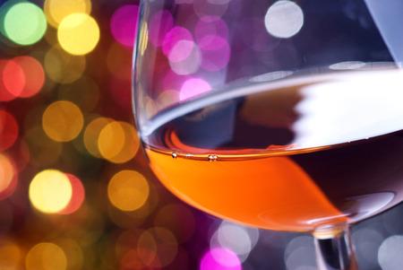 iluminated: Cognac glass on a color iluminated background Stock Photo