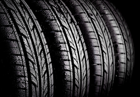 radial tire: Car wet tyres on a black background.