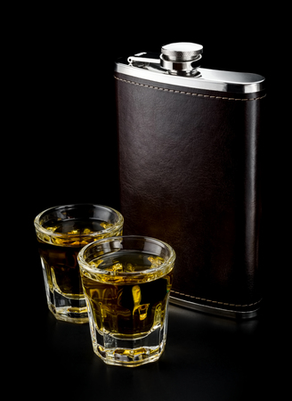 Steel flask and two baby shots of alcohol Stok Fotoğraf