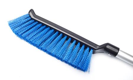 Blue plastic brush on white