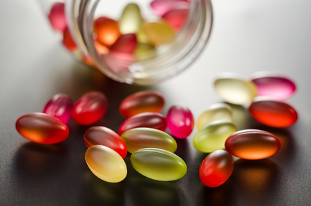 Oil fish pills from bottle closeup.