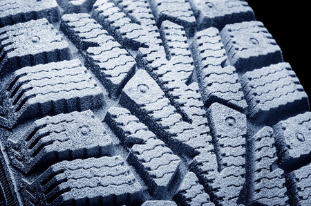 Winter studded tyre.Frosted protector. Foto de archivo