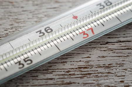 Glass mercury thermometer with celsius degree.
