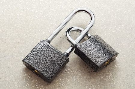 Two padlocks each other closed. Imagens
