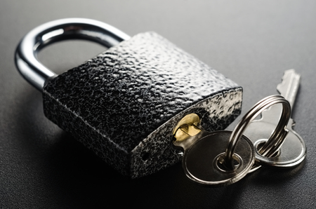 Closed padlock with keys.Secure object.