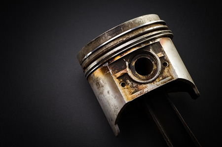Old piston engine on a black. Imagens