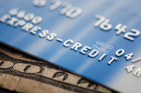 Close-up credit card and dollar cash.