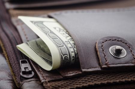 Cash money in leather wallet pocket. Imagens