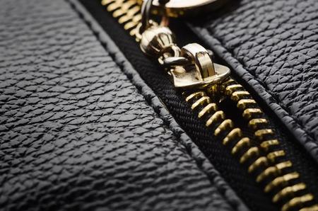 Zipper for handbag clothing accessories closeup.