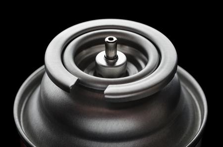 Can of gas butane on a black closeup