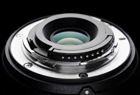 Dslr mount lens on a black background. Imagens