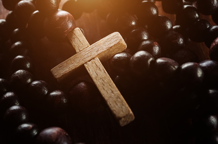 Closeup of wooden cross and rosary