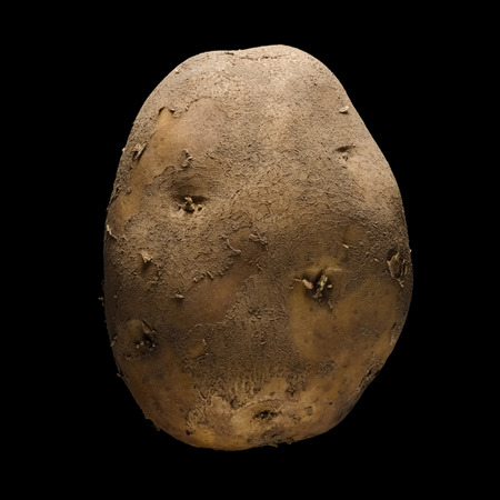 Isolated potato on a black background