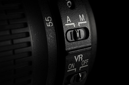 Manualauto focus switch button on camera lens.