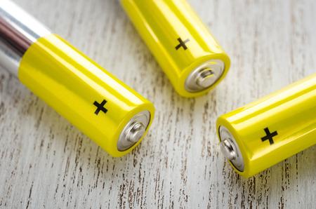 AA yellow alkaline batteries close up.