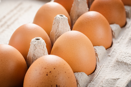 Eggs in a paper tray closeup.