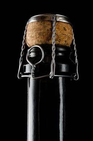 Champagne closed bottle on a black