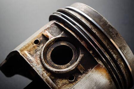 Old dirty piston engine on a black closeup Reklamní fotografie