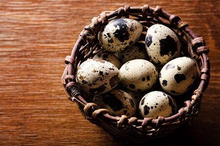 Quail eggs in basket closeup