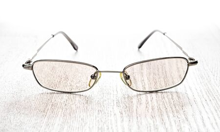 Protection computer eyeglasses on wooden table