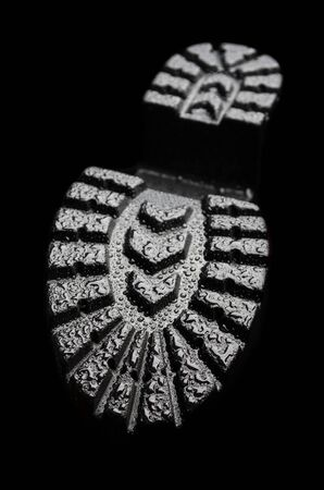 Boot wet tread on a black background Banque d'images