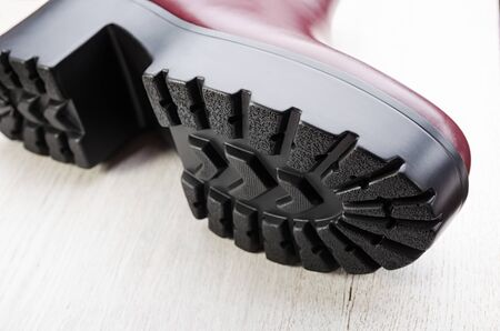 Boot tread on a wooden background