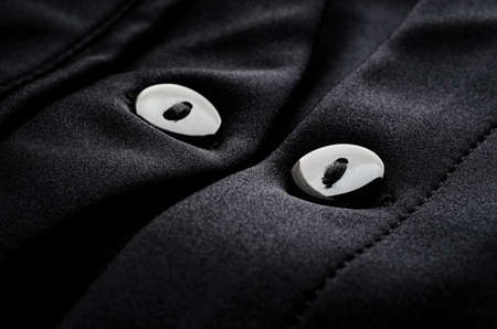 Detail of the buttons of a black jacket Foto de archivo