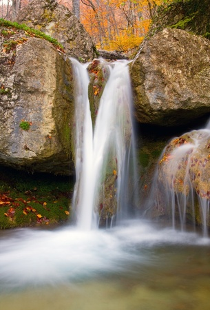 Nice waterfall on mountain river in autumn forest Stock Photo - 8438906