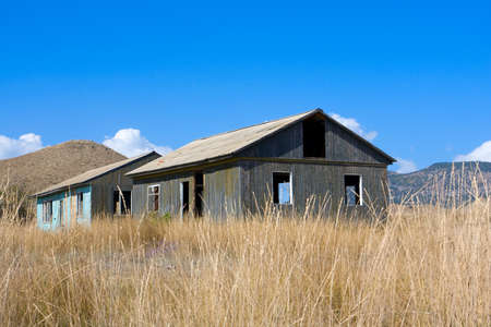 dryed: Two old abandoned houses in mountains Stock Photo