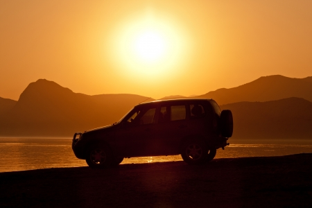 car on sunset background near sea Stock Photo