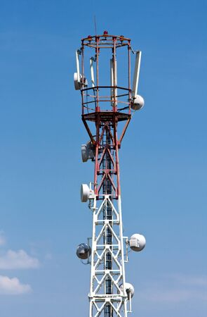 Telecommunication tower on blue sky background photo