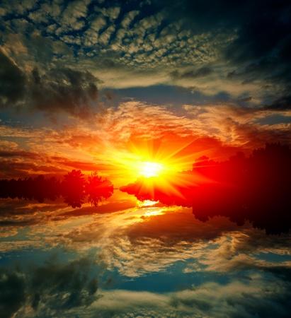 hot sunst scene on lake Stock Photo - 13751087