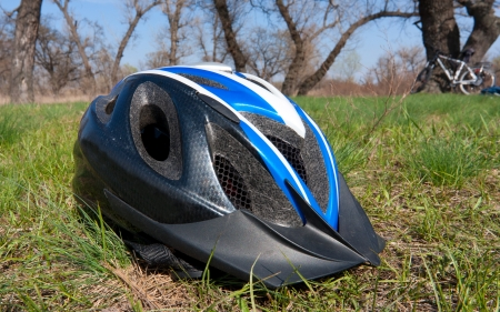 helmet on grass in forest