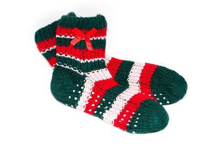 childs knited socks on white background photo