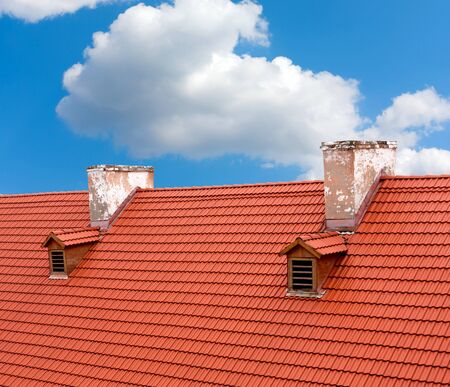 Red tile roof of old house photo