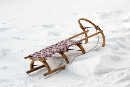 wooden sledge on snow in winter
