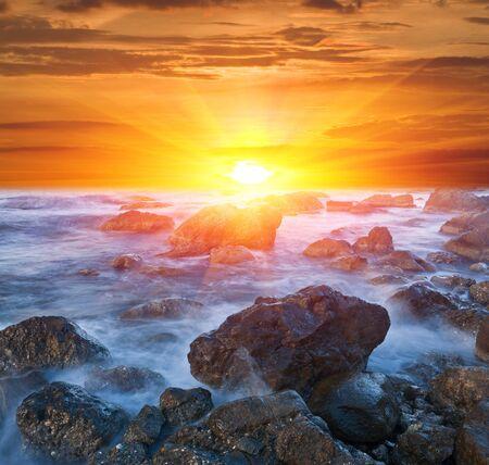 Sunset scene on sea coast Stock Photo - 13765325